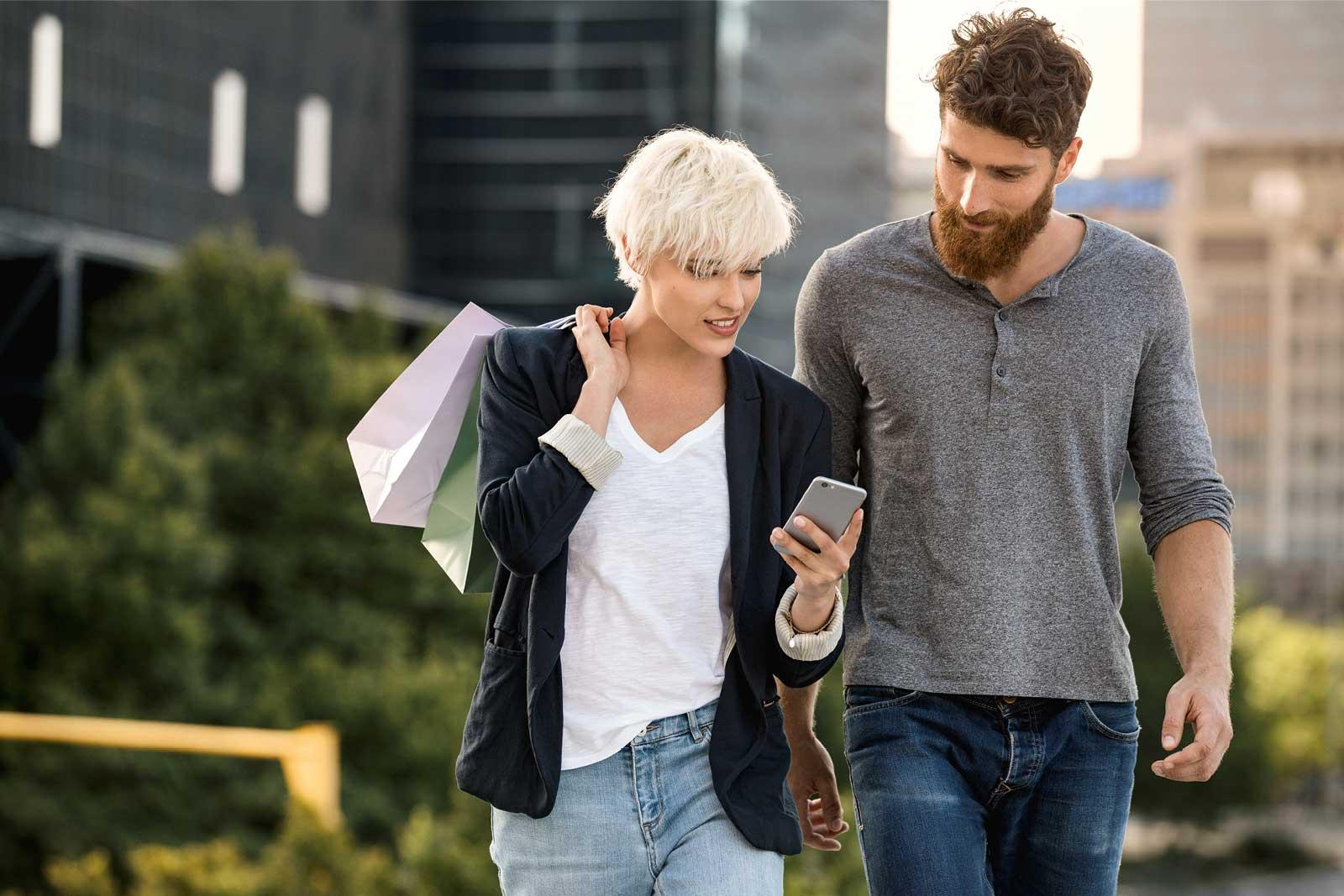 young-couple-man-woman-walking--street-phone-teaser.jpg
